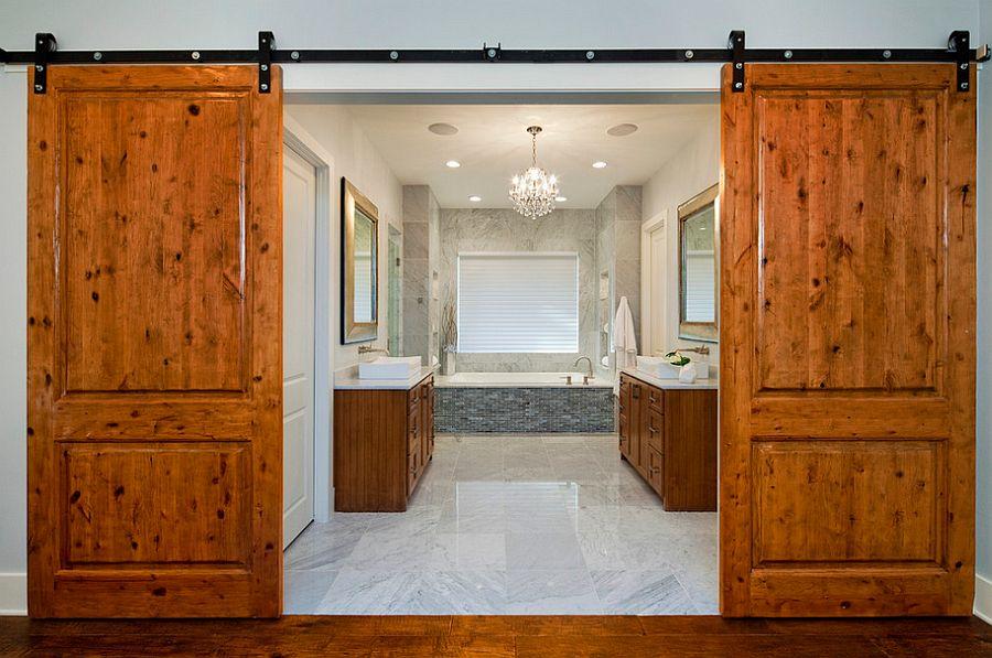 Barn doors bring rustic simplicity to the modern bathroom