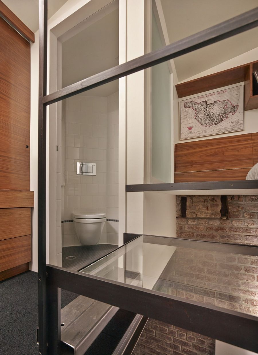 Bathroom and glass landing area leading to the loft bedroom