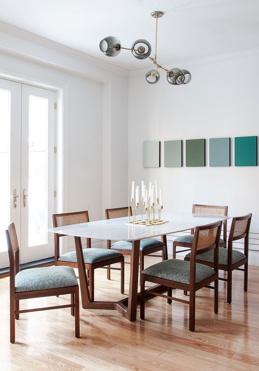 Formal dining room with chic upholstered vintage chairs