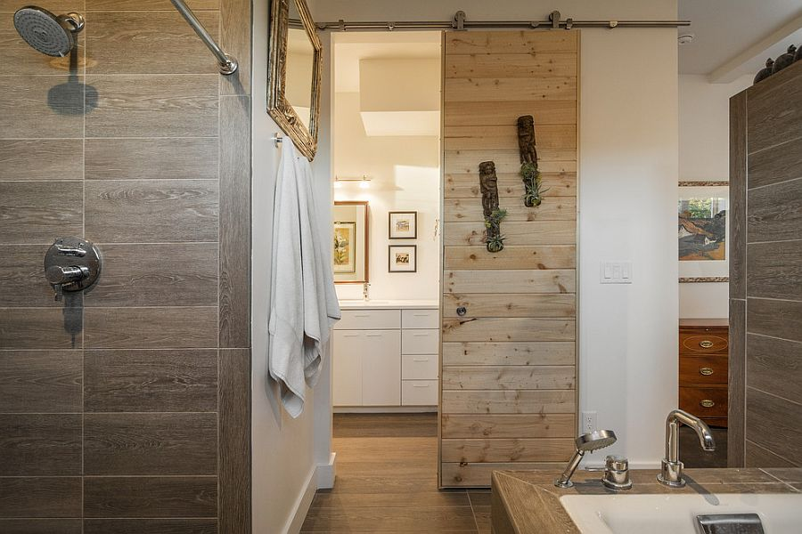 Sliding barn door saves up space in the small contemporary bathroom