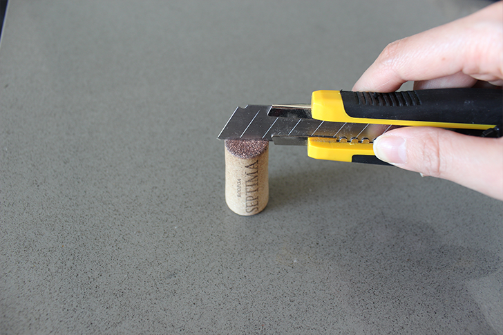 Use a blade to cut into your wine cork