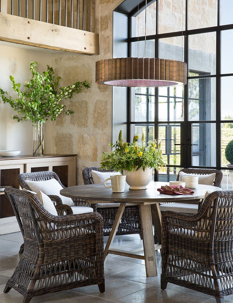 Use of natural materials for the dining table and chairs adds to the Farmhouse style