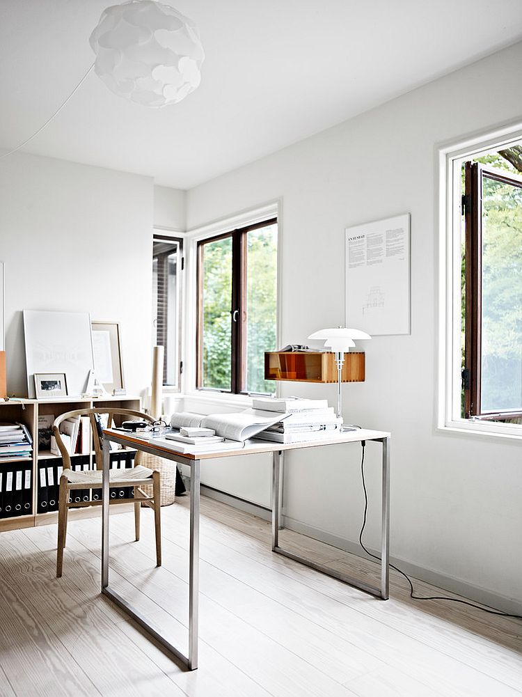 Wishbone chair and sleek desk give the home office an airy ambiance