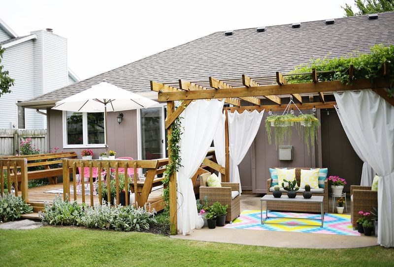 Backyard patio lounge with a pergola