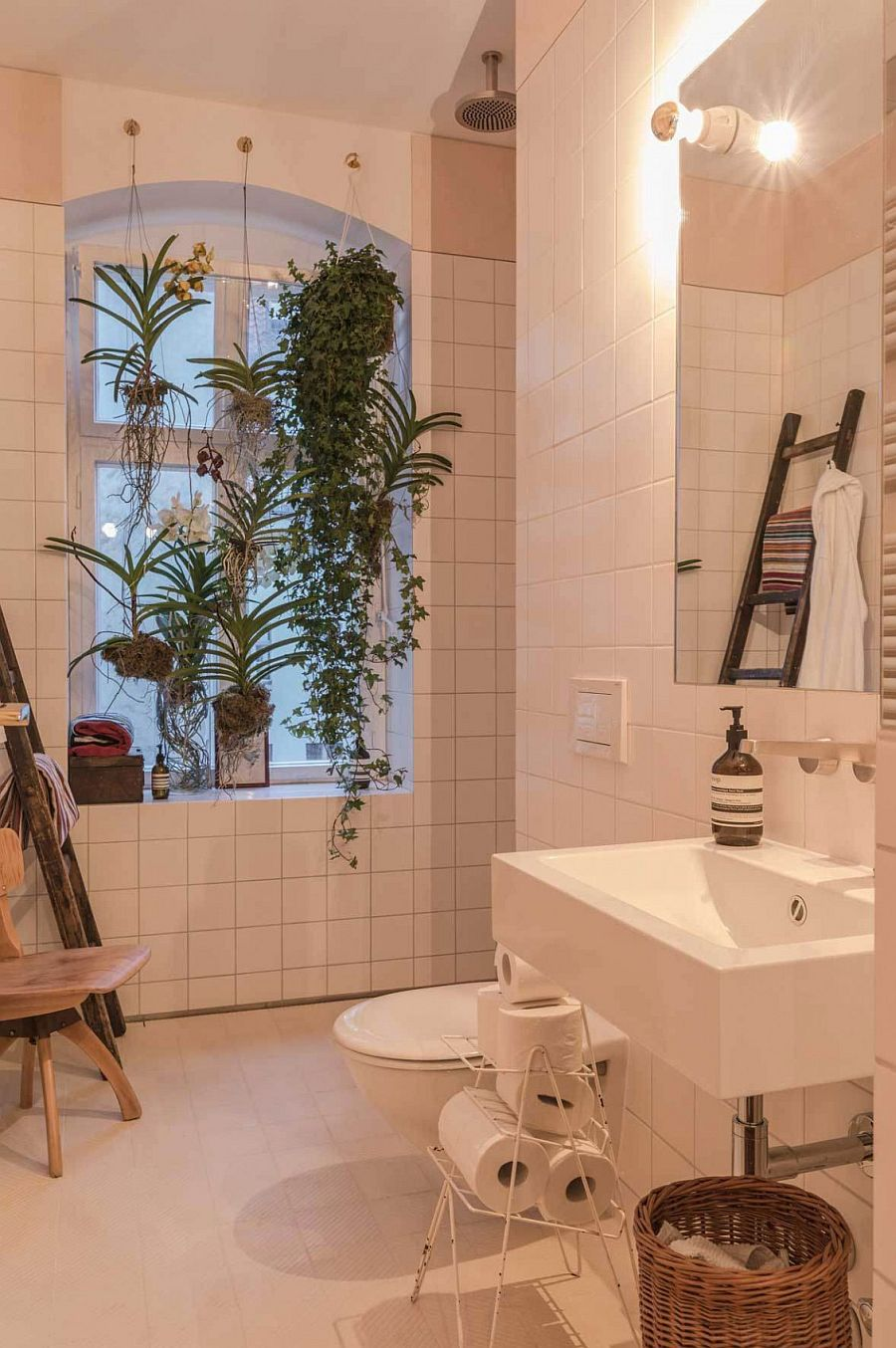 Bathroom in white filled with hanging plants
