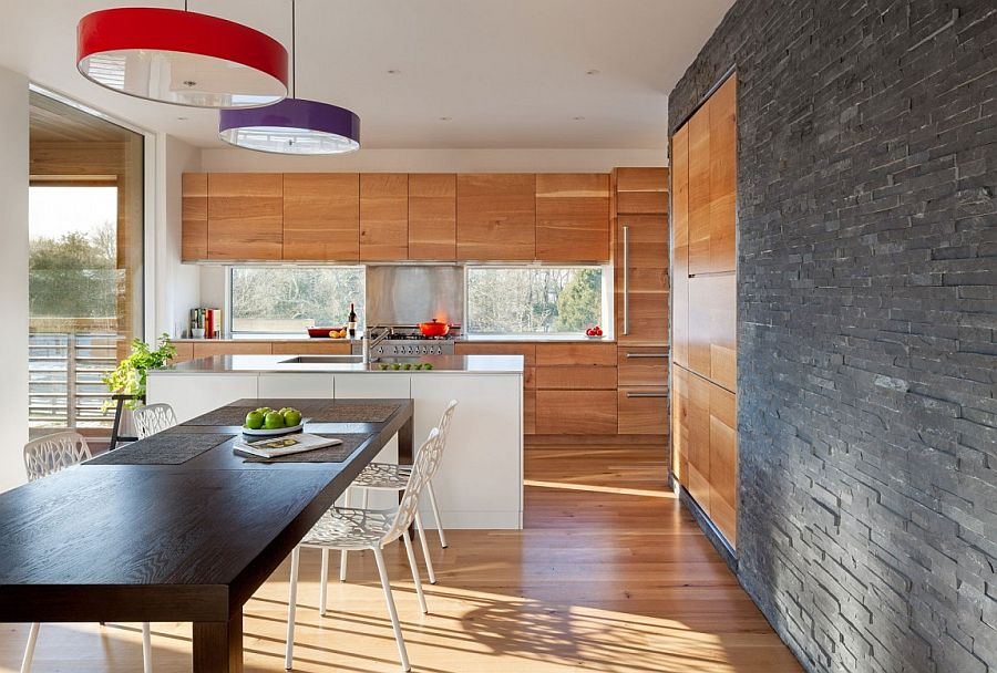 Cedar wood and copper come together to shape the elegant kitchen