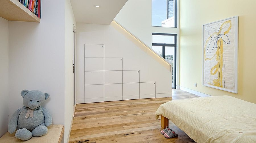Contemporary kids' bedroom with smart storage solutions