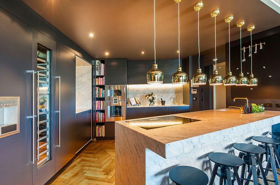 Copper pendants add metallic glint to the contemporary kitchen [Design: Yohm]
