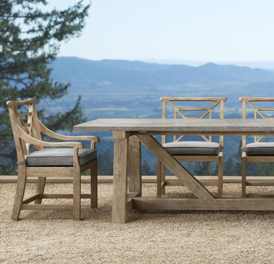 Concrete and teak trestle table from Restoration Hardware