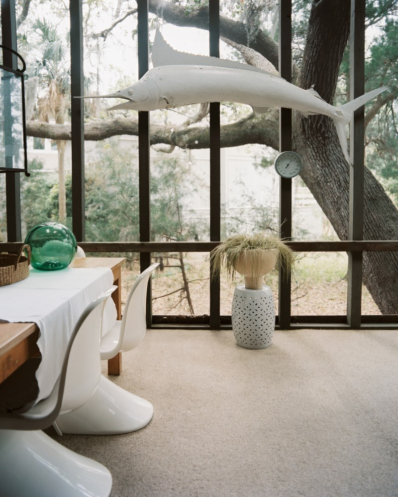 Quirky decor in a screened-in porch