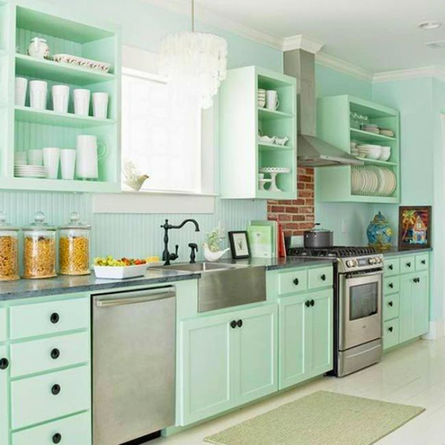 Kitchen with pale green beadboard and splashes of stainless steel