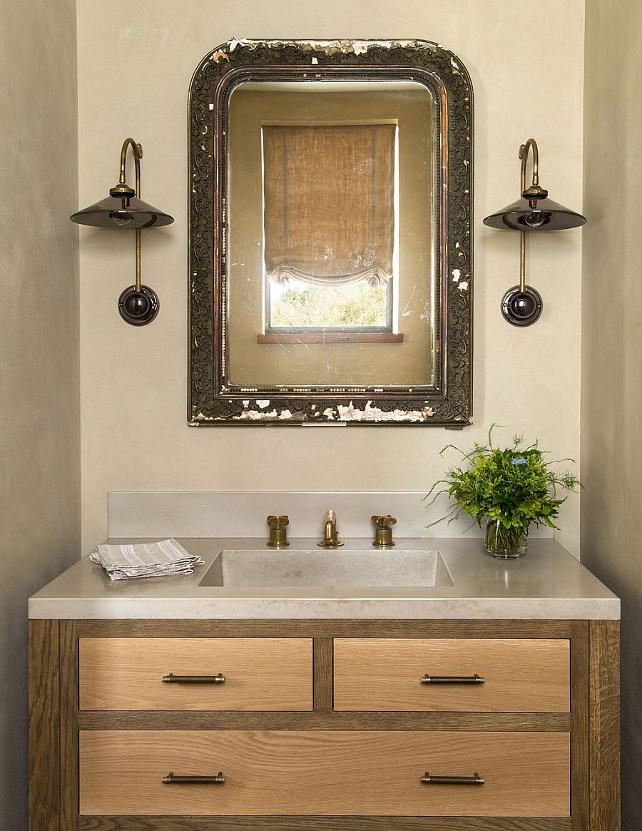Antique English mirror and French sconces for the rustic powder room