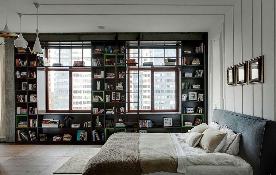Bedroom with bookshelf and Tom Dixon pendants