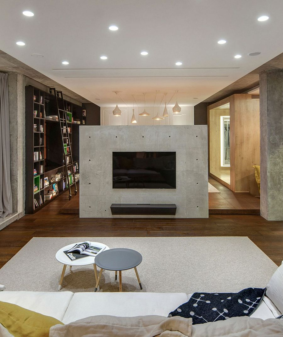 Concrete fireplace acts as a divider between two different zones