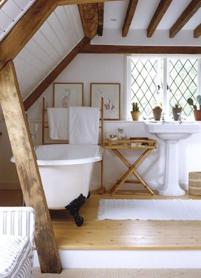 Rustic attic bathroom with wooden beams