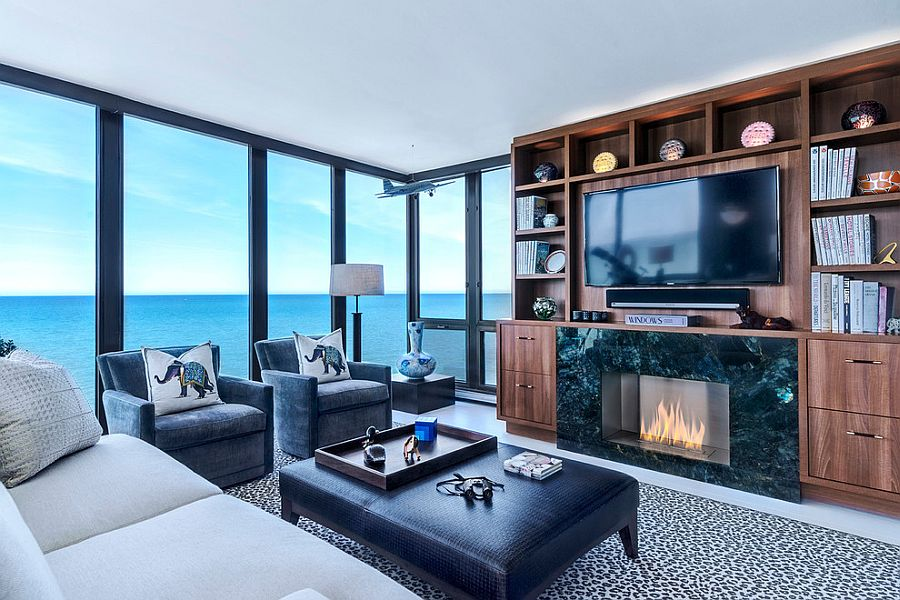 Stunning sunroom with Walnut Entertainment Center and ocean views