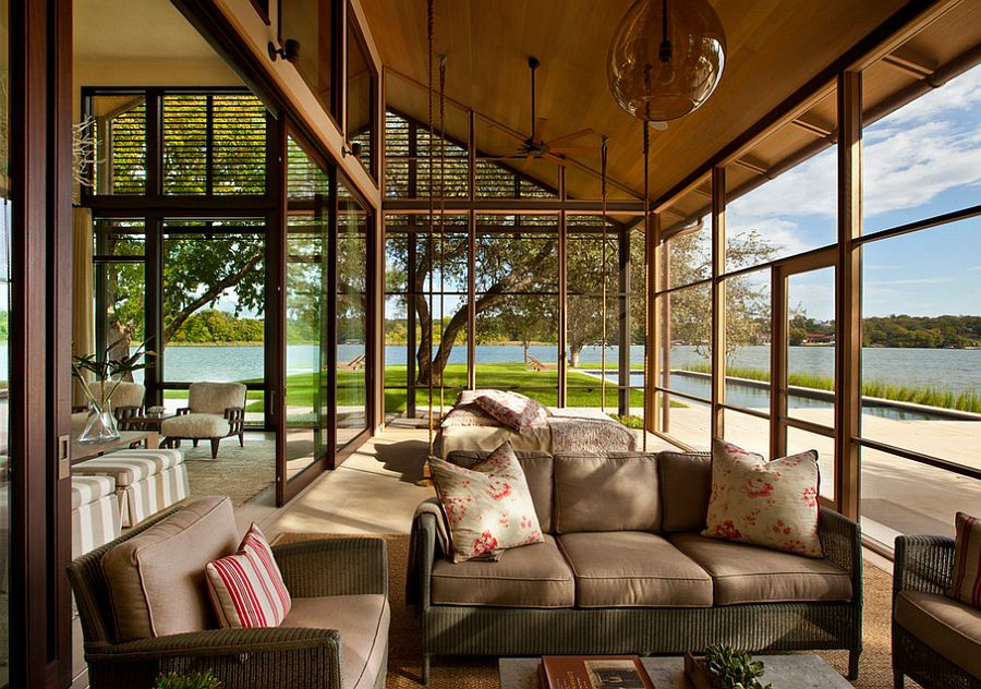 Suspended bed and sliding glass doors for the sunroom with lake views