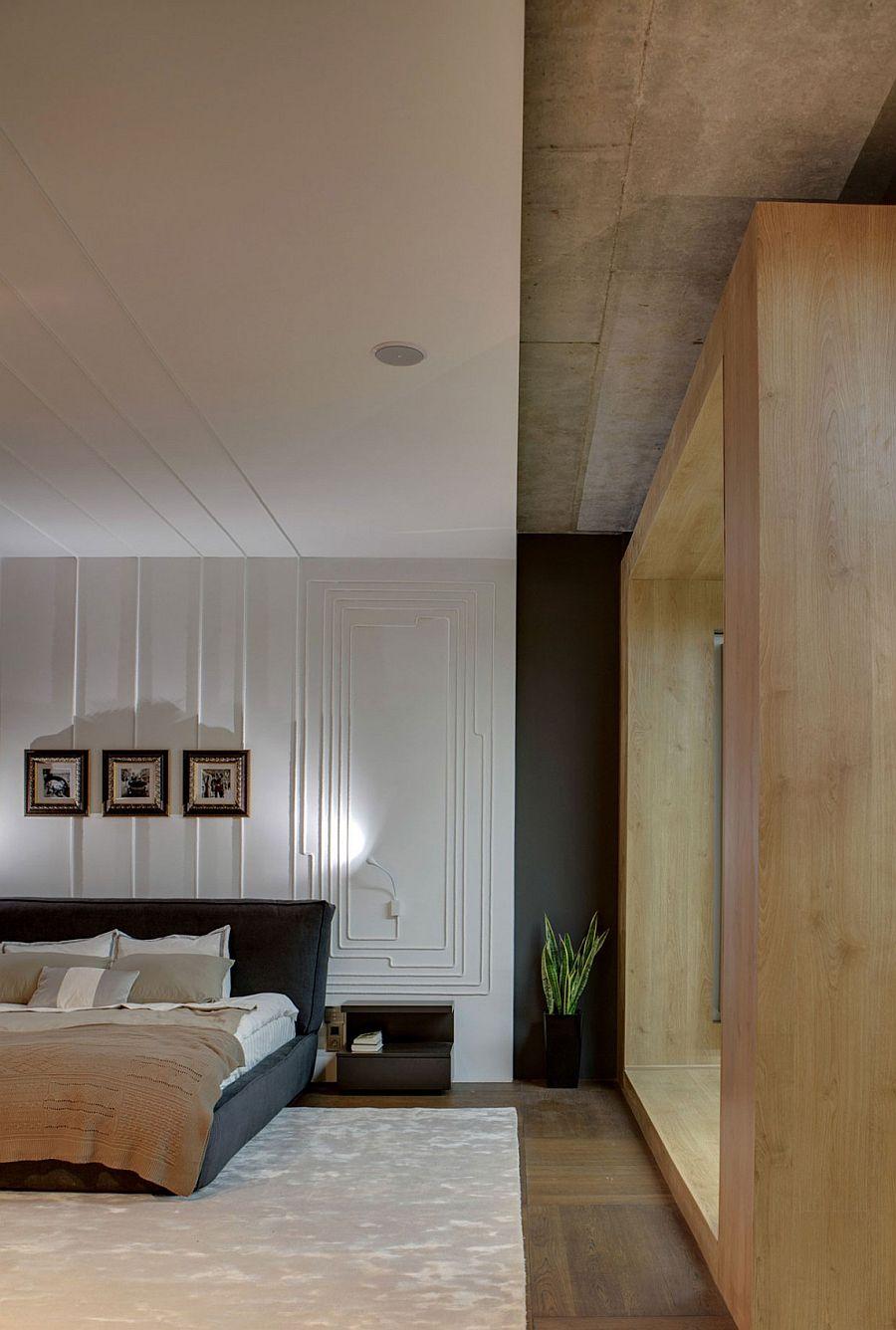 Unique headboard wall and bedside lighting idea
