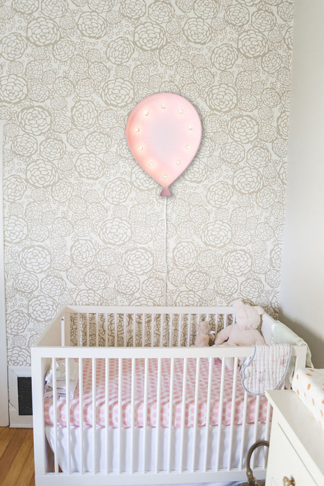 Balloon-shaped marquee sign hung above crib