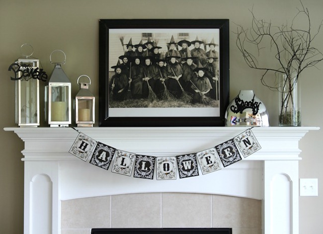 Black and white Halloween fireplace mantel with family photo of witches