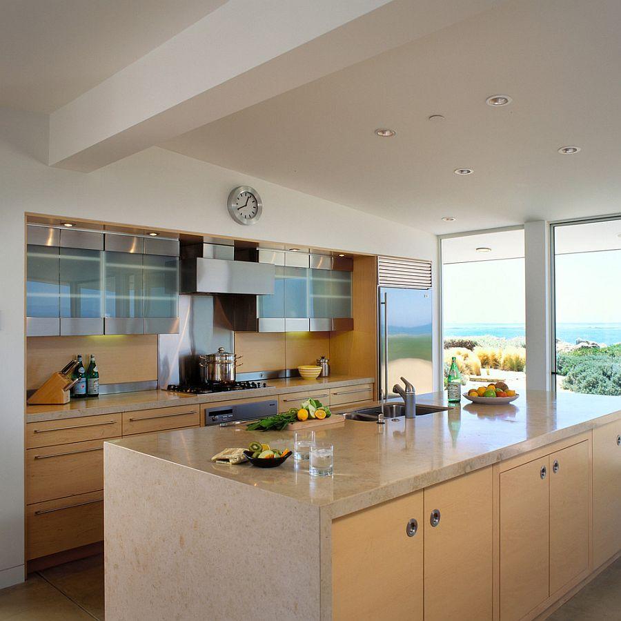 Clean and crisp kitchen design with stone worktop