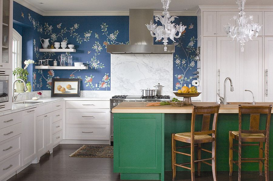 Colorful kitchen island with buther block top, wallpapered wall and marble backsplash come together in this kitchen