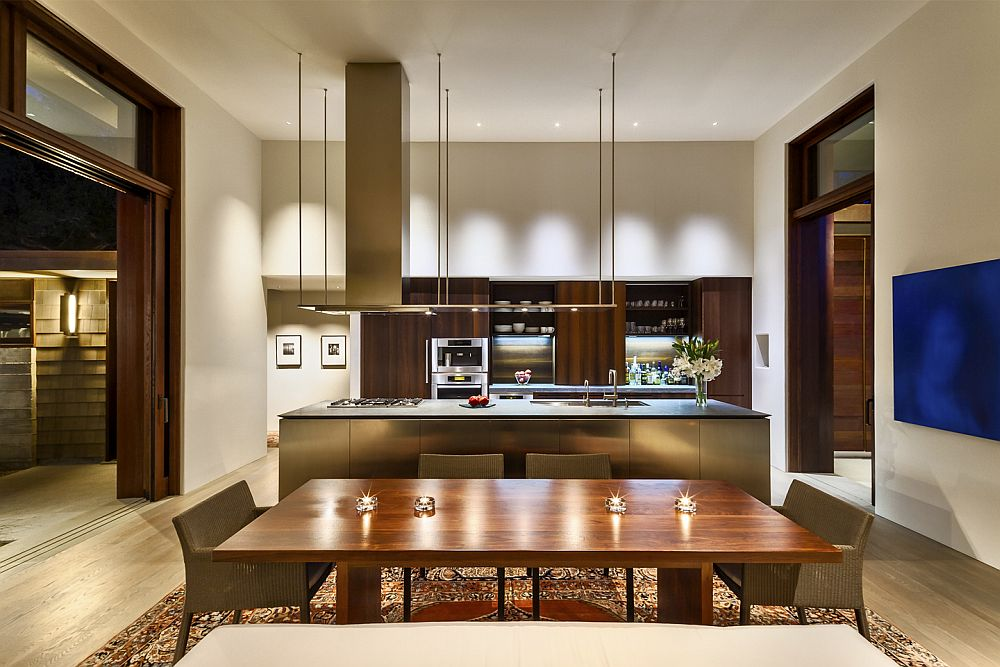 Custom Boffi kitchen with a sleek island and an integrated hood above steals the spotlight