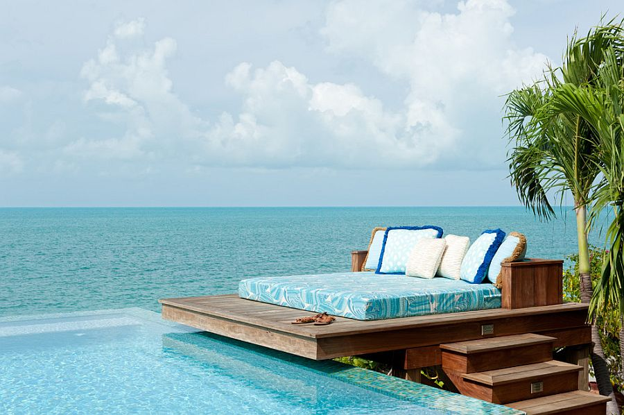 Dream deck next to the pool and ocean blends tropical flavor with beach style