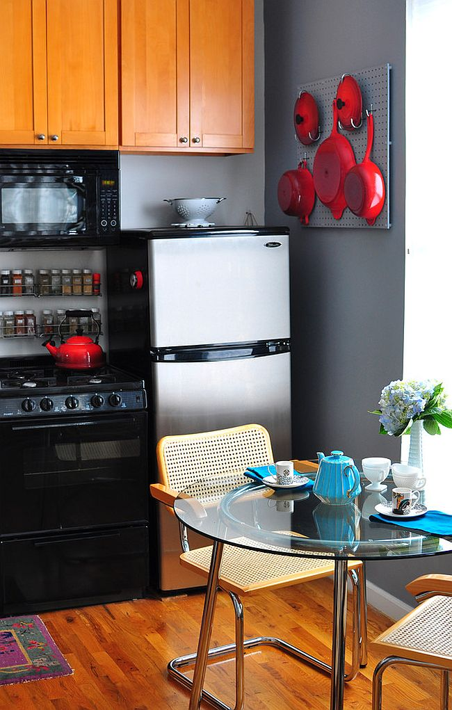 Kitchenware adds bright red to the small kitchen in black and gray