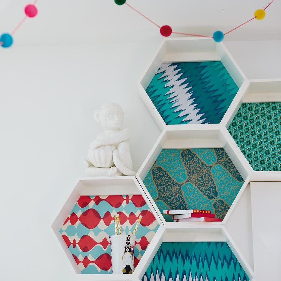 Patterned backing on wall shelving from The Land of Nod