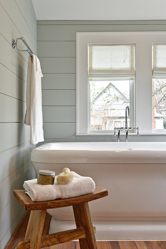 Rustic zen style stool beside tub