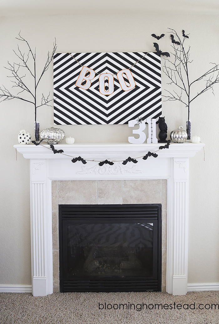 Simple black and white Halloween decor for a fireplace