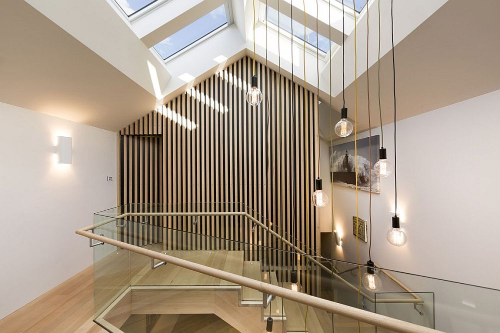 Skylights and staircase designe filter natural light through to the lower level of the home
