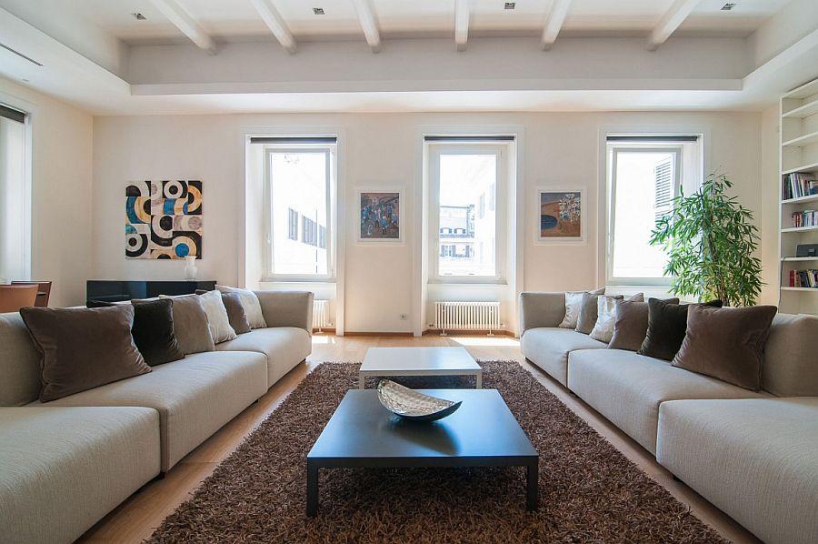 Windows bring natural light into the lavish living space