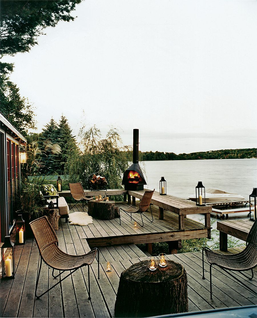 Fireplace and lighting give the lakeside deck a surreal appeal