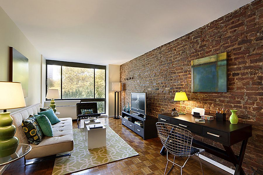 Living room of New York home proudly showcases original brick wall [Design: Designed To Appeal]