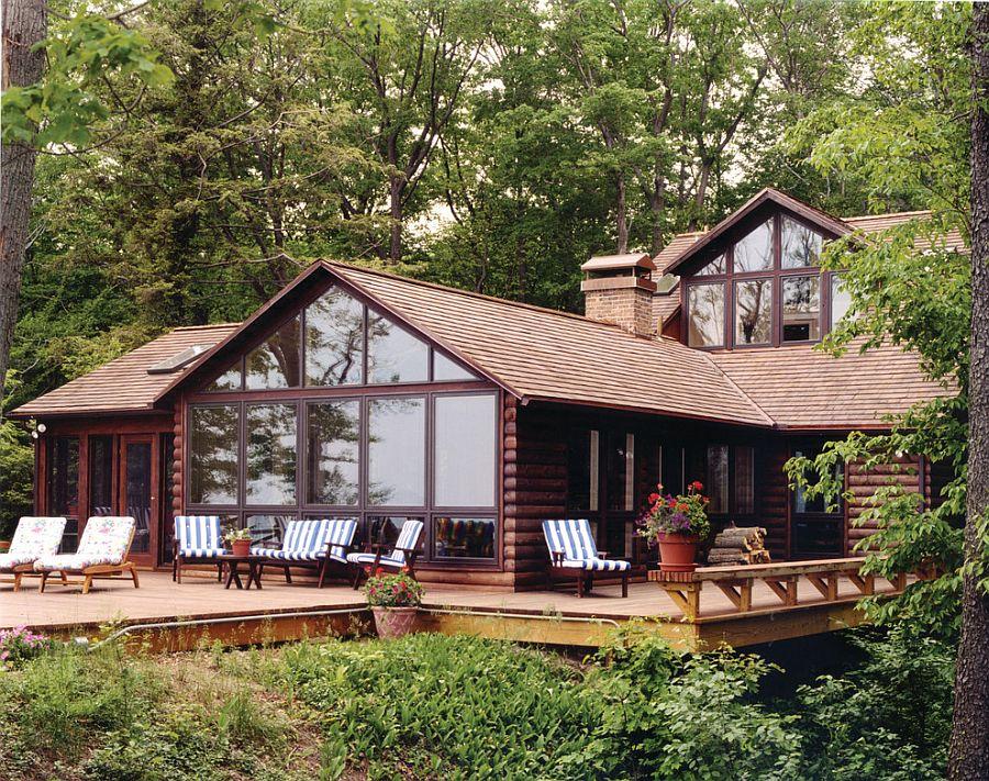 Log cabin deck embraces the natural landscape around it