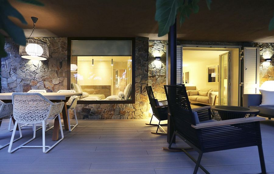 Stone walls and glass windows blend contrasting textures seamlessly