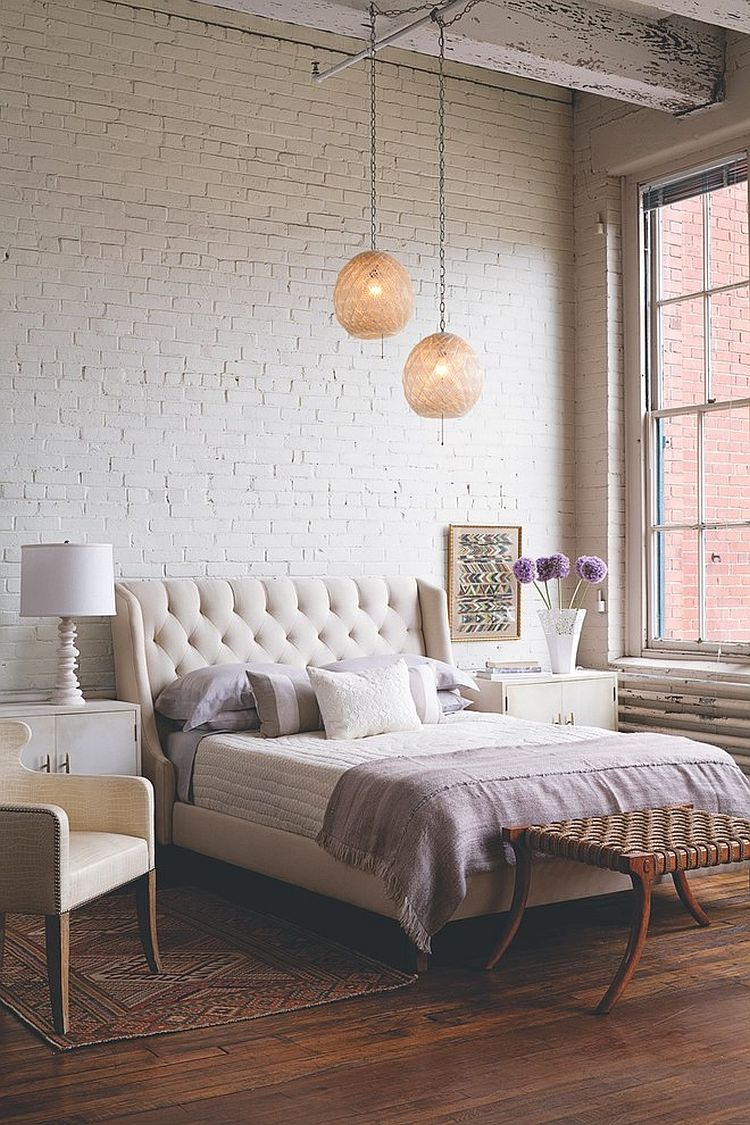 Bedding, lighting, rug and subtle details give this bedroom an air of femininity [Design: Twelve Chairs]