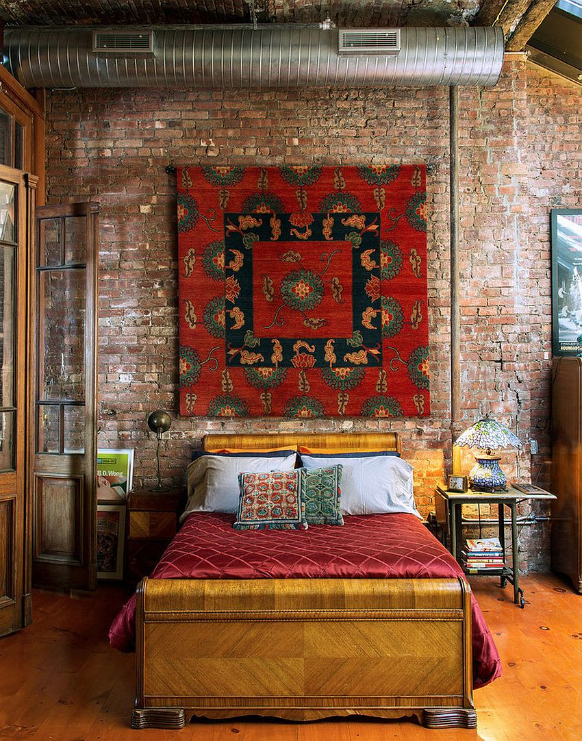 Bright and beautiful Tibetan rug on the wall of the eclectic bedroom in New York home [From: Ralo / Trevor Tondro]