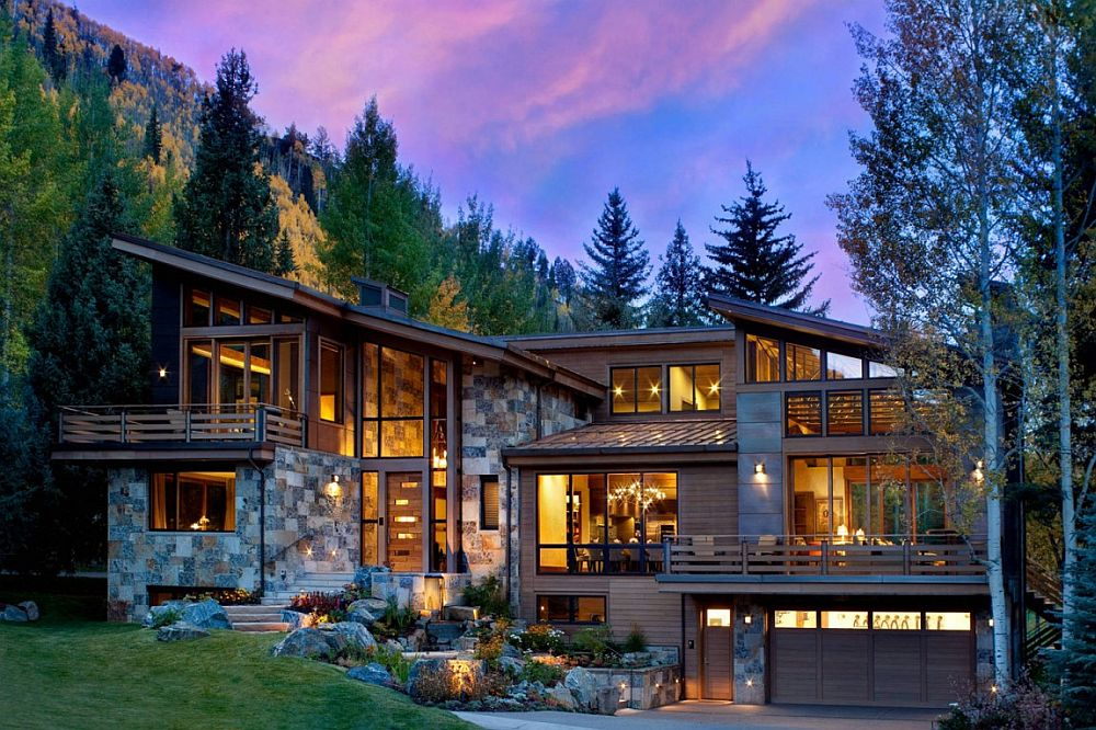 Exterior of the Ptarmigan Residence clad in natural dry-stack stone, copper paneling and clear cedar siding
