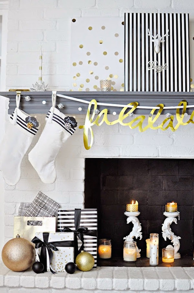 Fireplace mantel with white stockings and gold banner