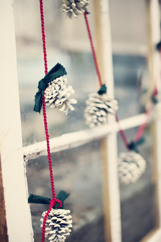 Frosted pinecone garland with green ribbon and red rope
