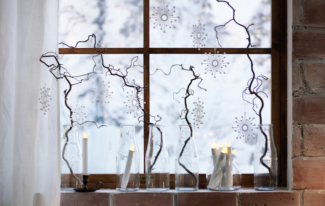 Glass bottles with branches and snowflakes