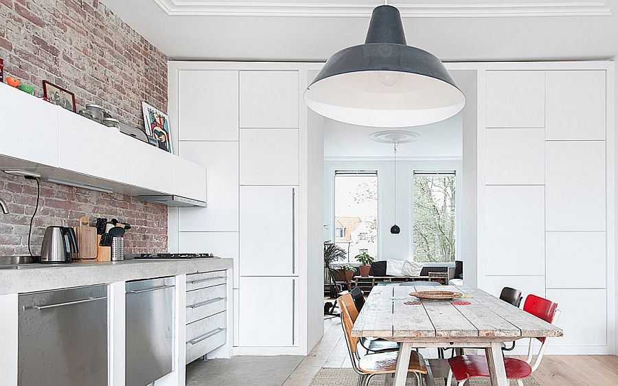Large industrial style pendant in gray adds personality to the small dining room kitchen combo