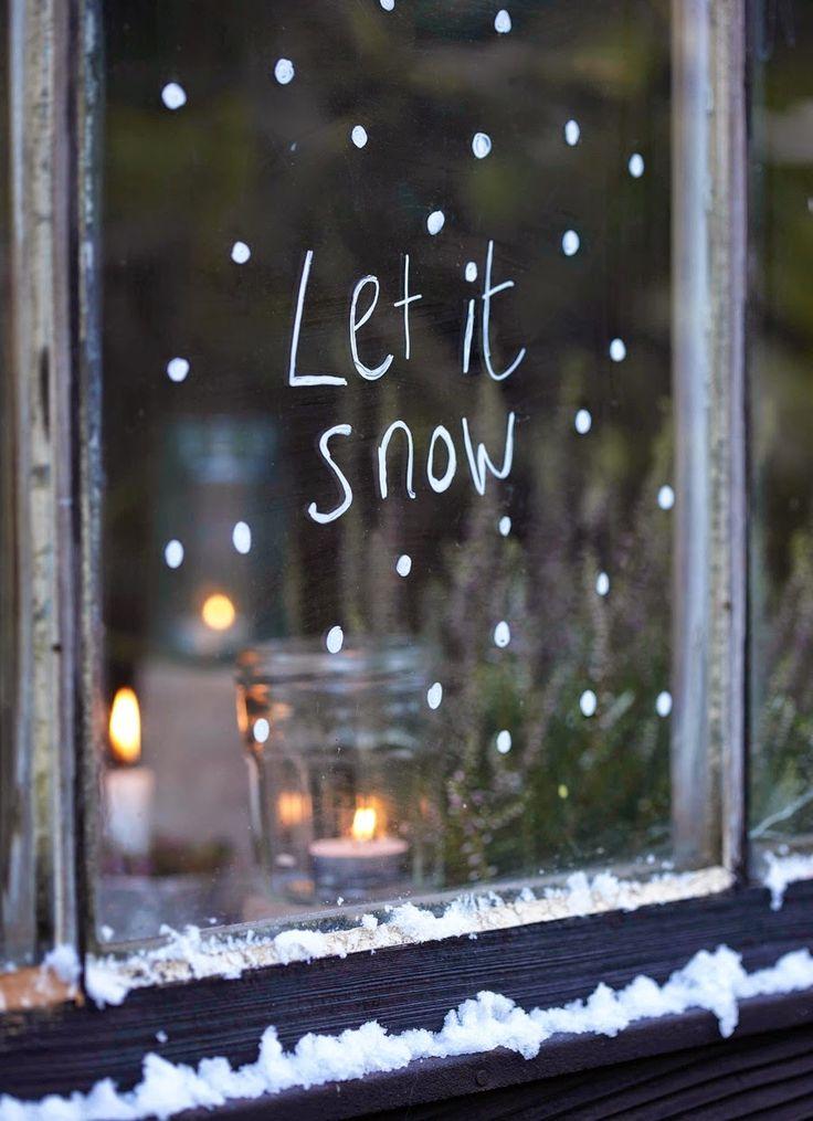 'Let It Snow' written on window in temporary white window marker