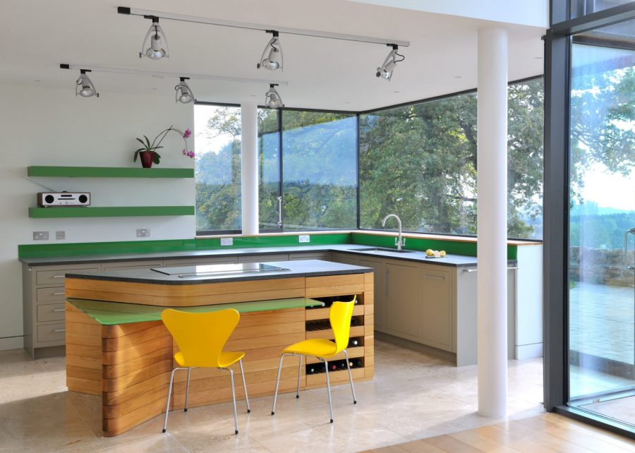 Spotlights in a kitchen with green accents