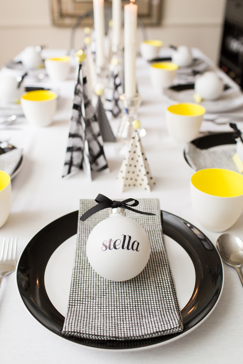 Tablescape with personalized ornaments and paper Christmas trees