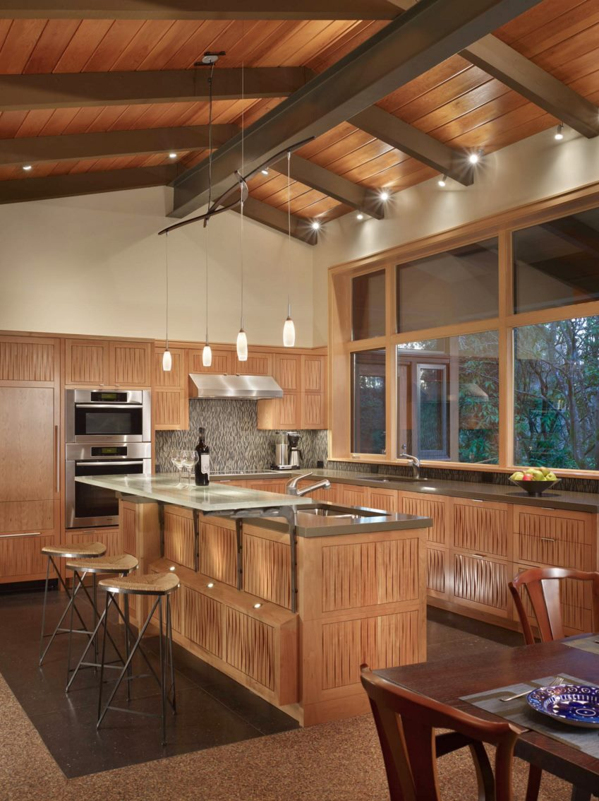 Variety of lighting selections in a modern kitchen with a warm glow