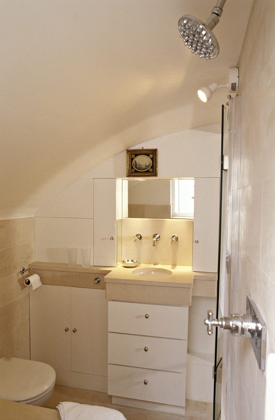 White bathroom with a wall-mounted spotlight